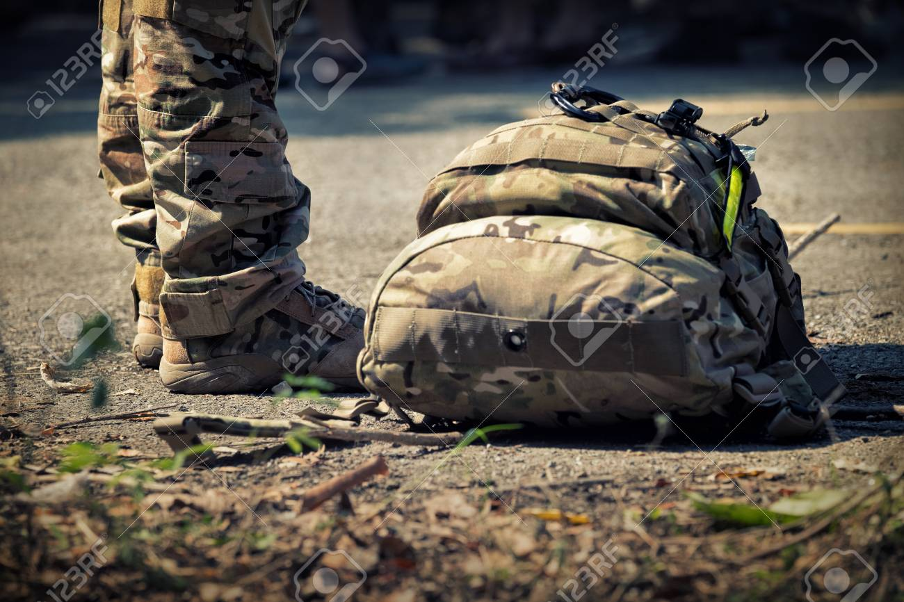 soldiers stand with bag. army, military boots lines of commando