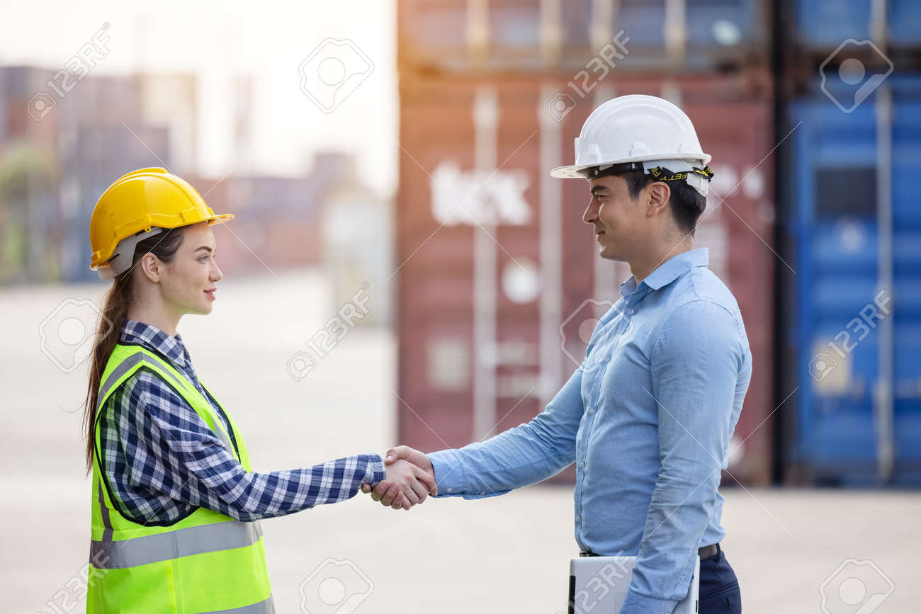 Teamwork cooperation of international container shipping multi ethnic Company. Successful Work concept. - 168359952
