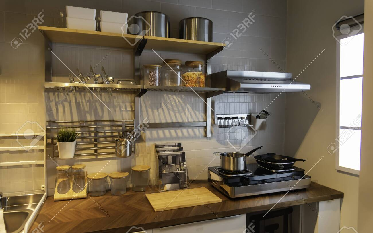 View of a traditional kitchen with a microwave oven table and..