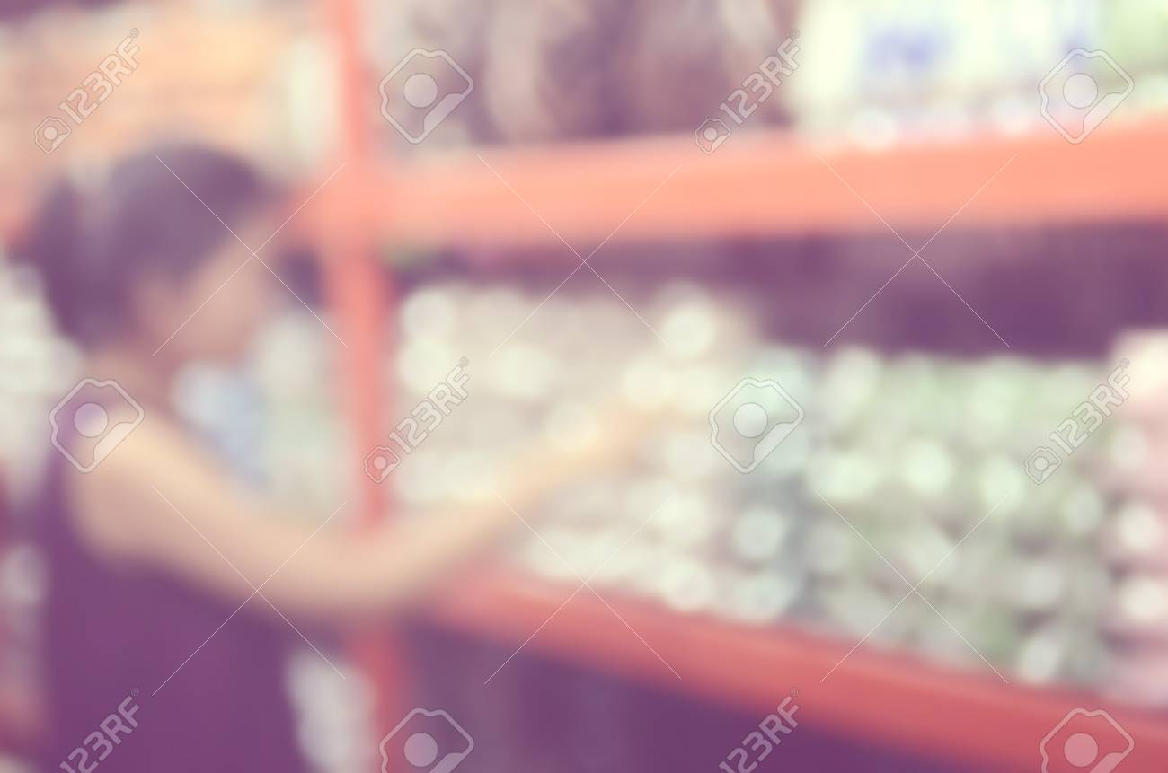 Blur woman shopping in shopping center mall abstract background Retro