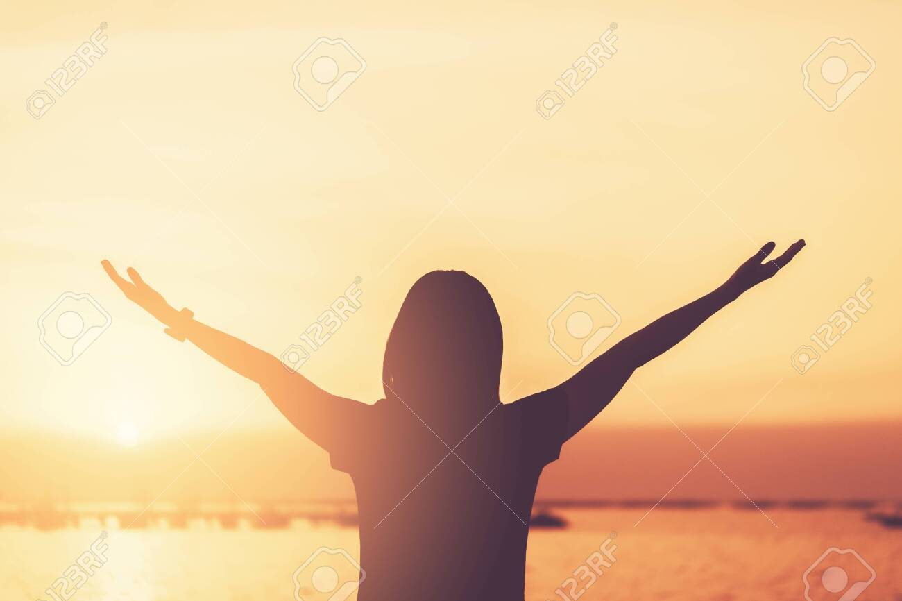 Copy space of woman rise hand up on sunset sky at beach and island background. Freedom and travel adventure concept. Vintage tone filter effect color style. - 138831815