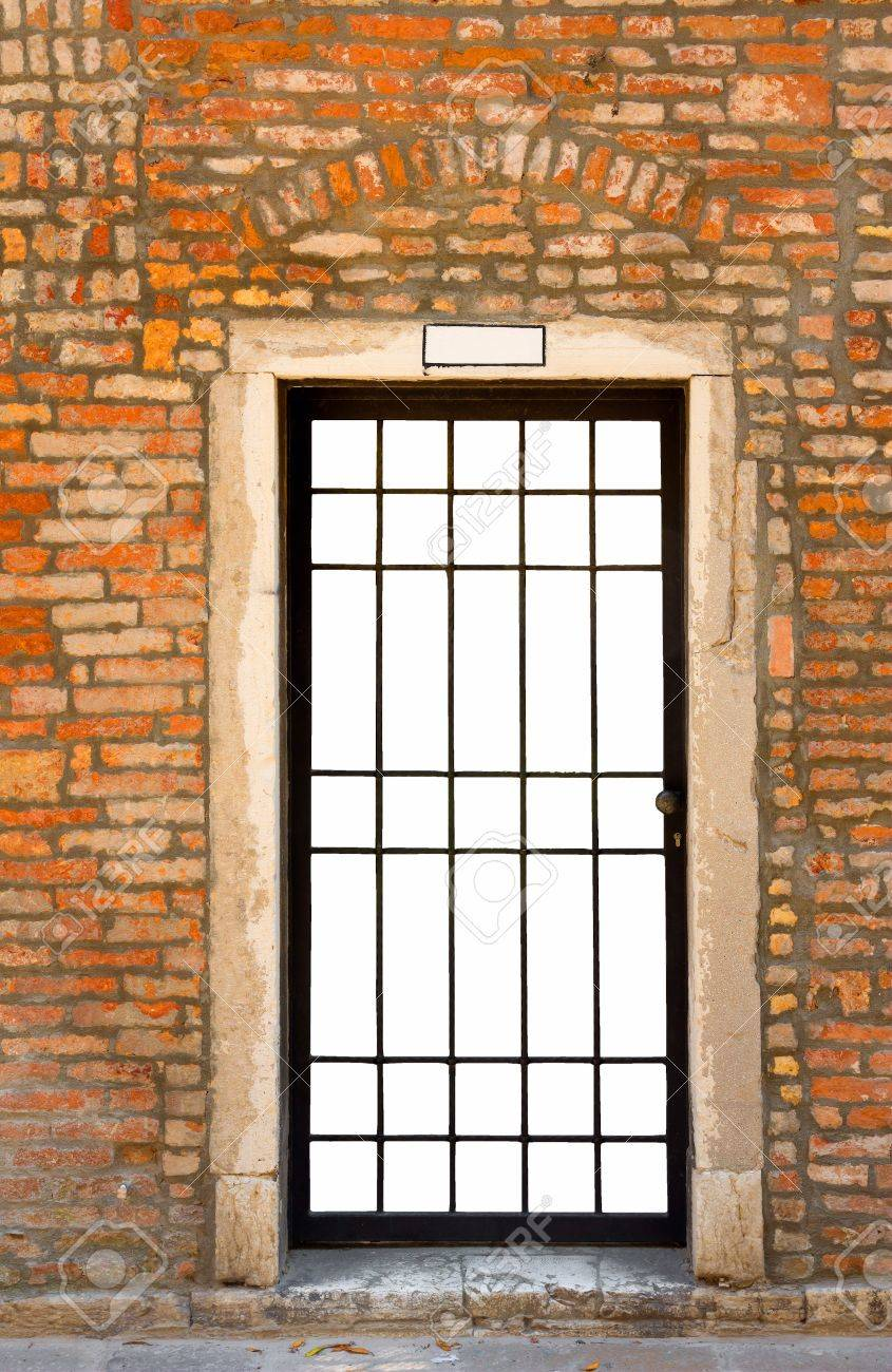 Merveilleux Metal Bar Door In Old Brick Wall, Isolated On White Stock Photo   15315960