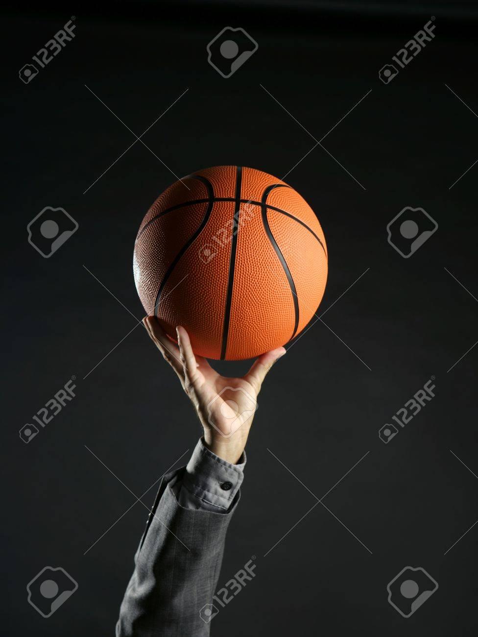 Businessman with basketball ball, teamwork, leadership metaphor Stock Photo - 4097058