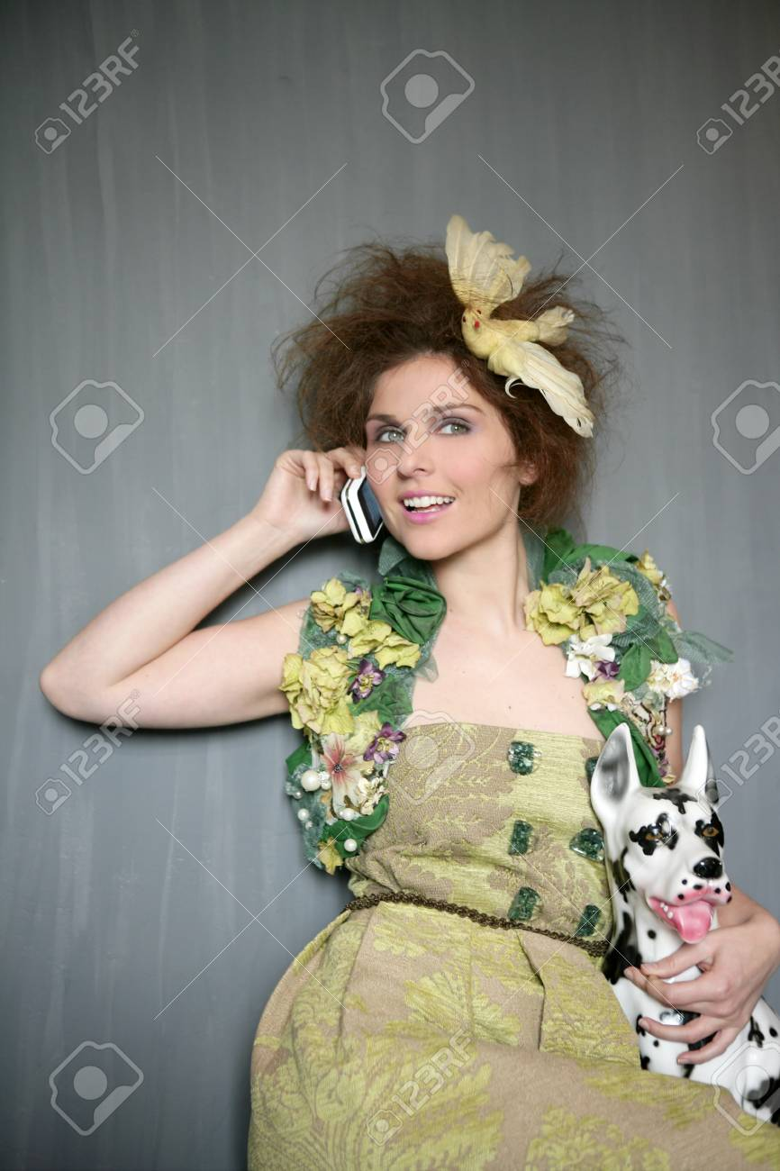 Modern fashion original woman talking phone with dalmatian dog Stock Photo - 4280200