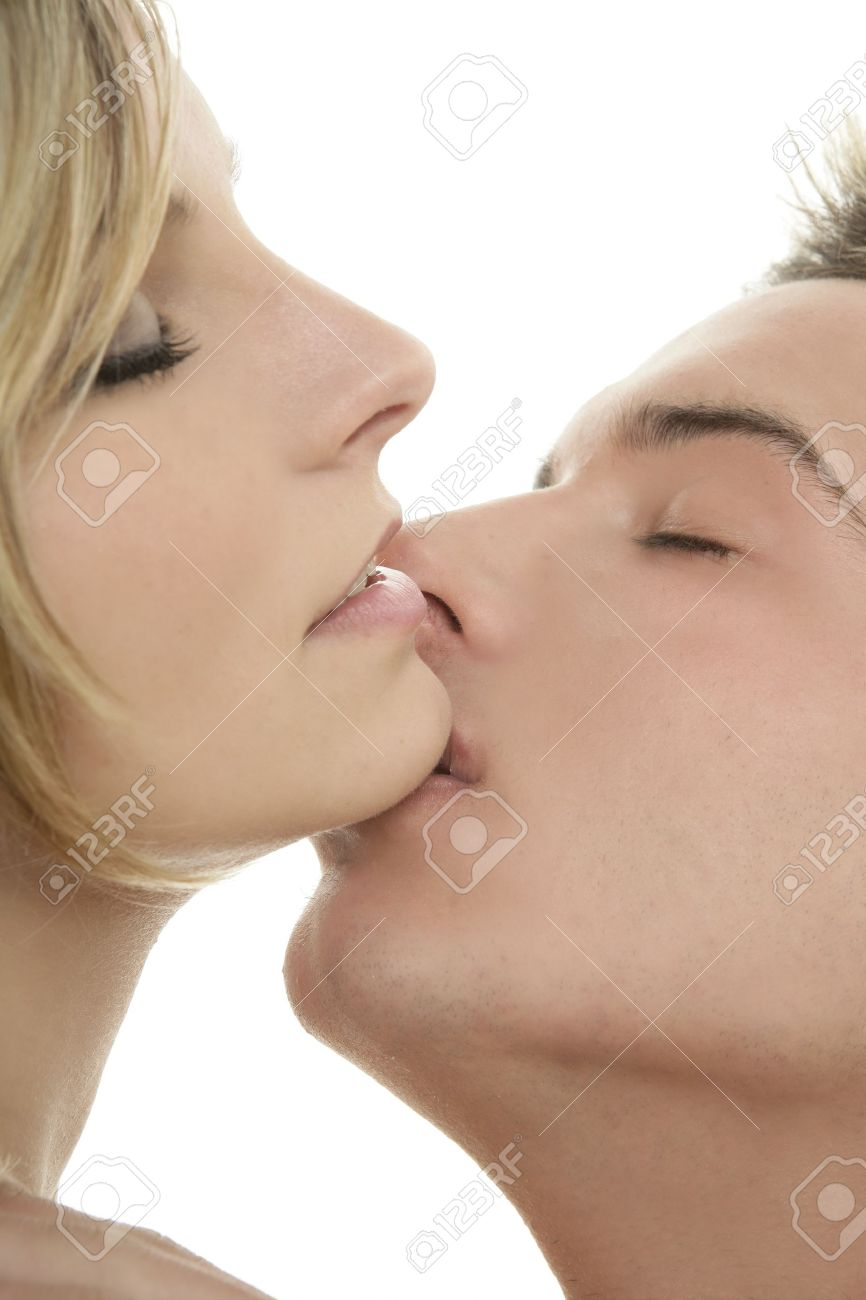 Couple natural kiss close up portrait over white background Stock Photo - 4360115