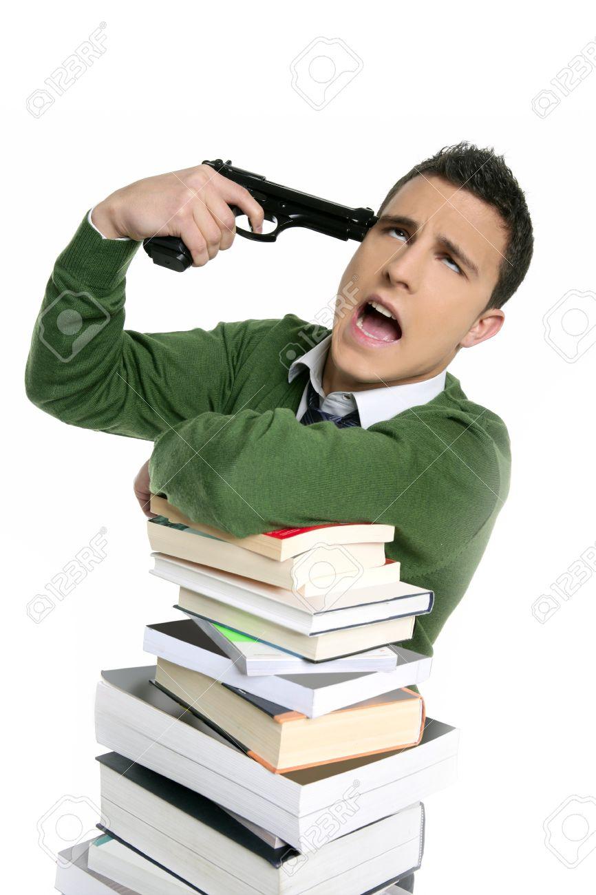 Unhappy sad student suicide gun metaphor, stacked books over white Stock Photo - 4400423