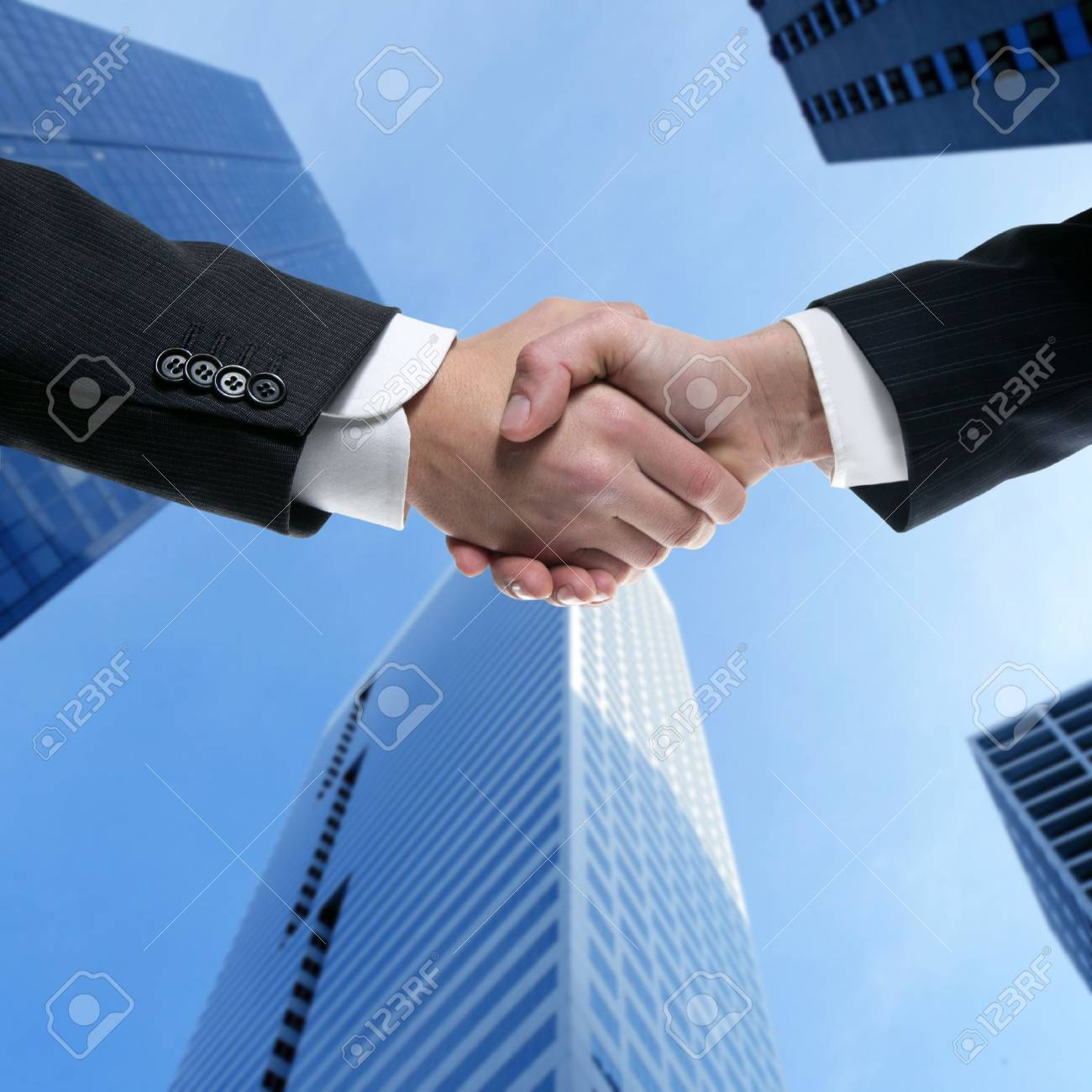 Businessman teamwork partners shaking hands with suit Stock Photo - 4400478
