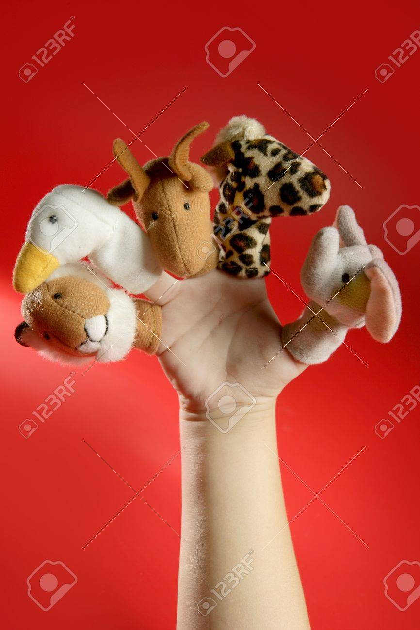 Finger puppets on a toddler hand over red background Stock Photo - 4439742