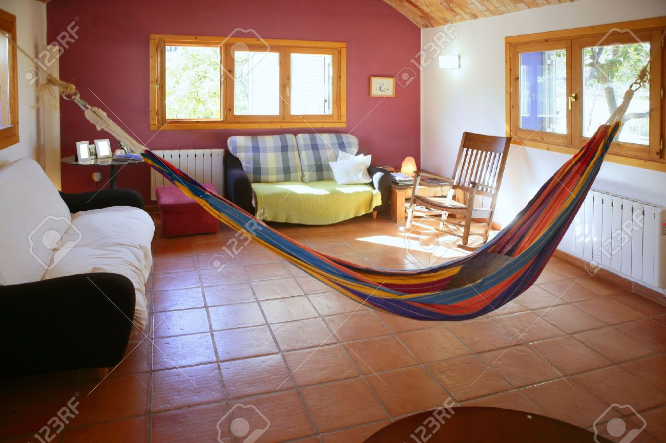 Nice Living Room With Colorful Hanged Mexican Hammock In Spain Stock Photo