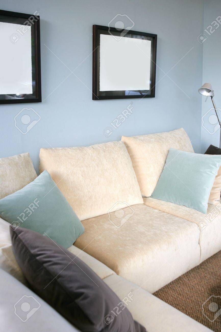 Blue and cream living room - Living Room With Cream Sofa Soft Blue Wall Interior Design Stock Photo 4763343