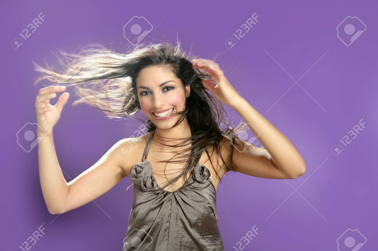 Brunette indian beautiful woman dancing at studio on purple background Stock Photo - 5258199