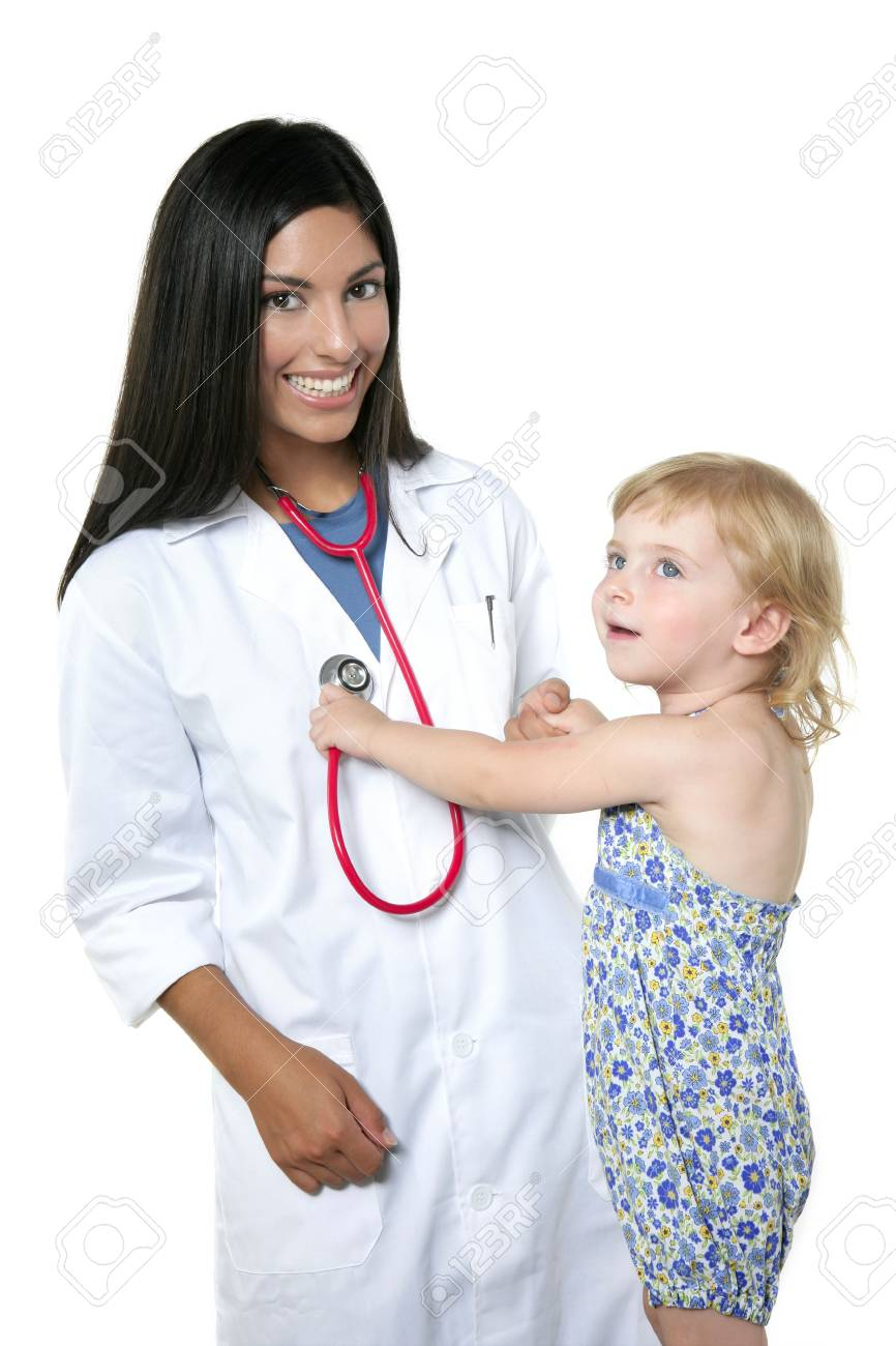 Brunette pediatric doctor with blond little girl on medical exam Stock Photo - 5572817