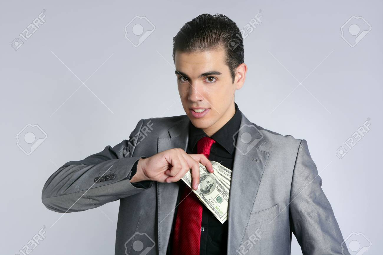 Businessman young with dollar notes suit and tie on gray background Stock Photo - 5725190