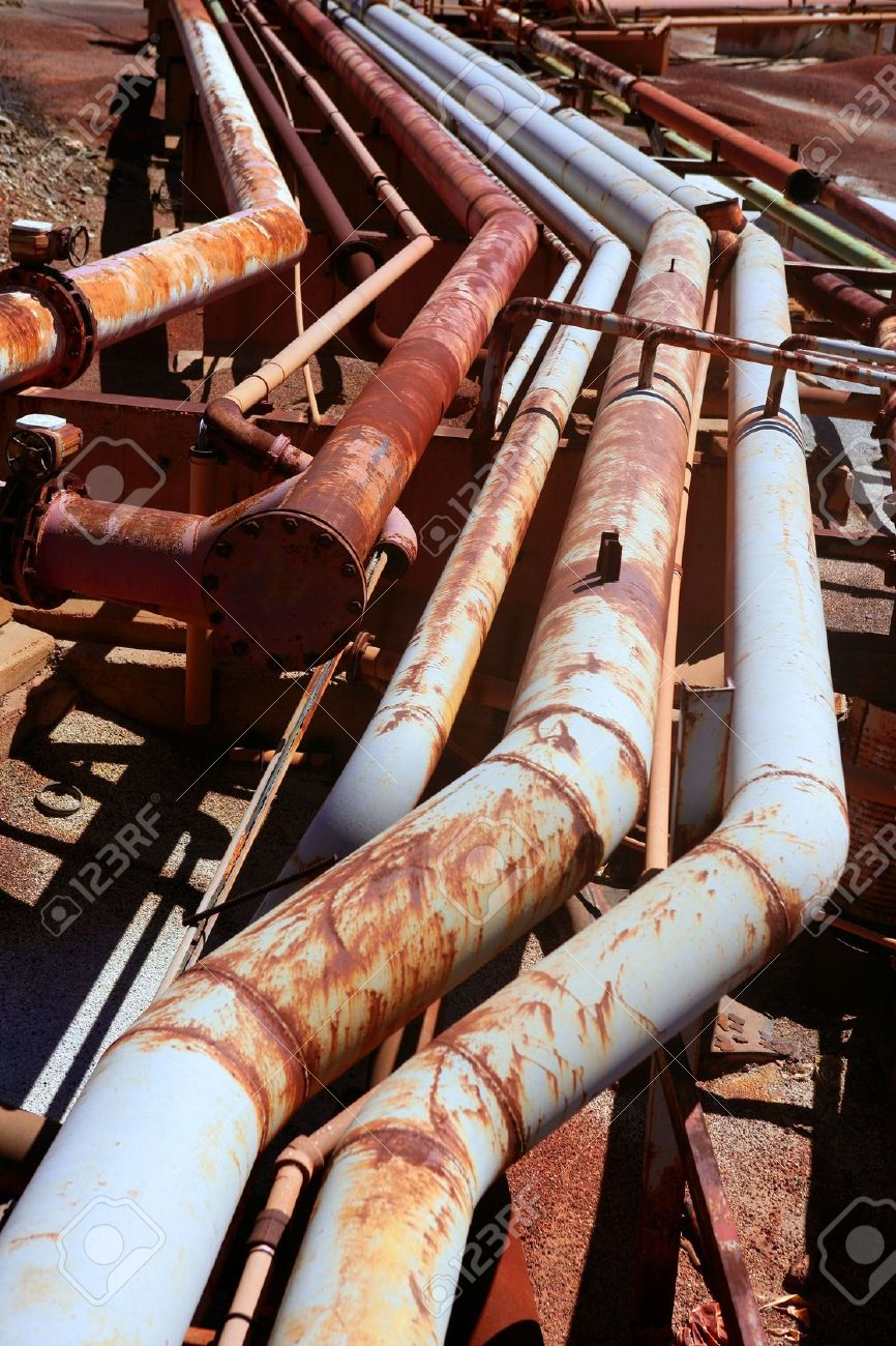 Aged rusty grunge industrial pipe lines on a mine industry Stock Photo - 5776902