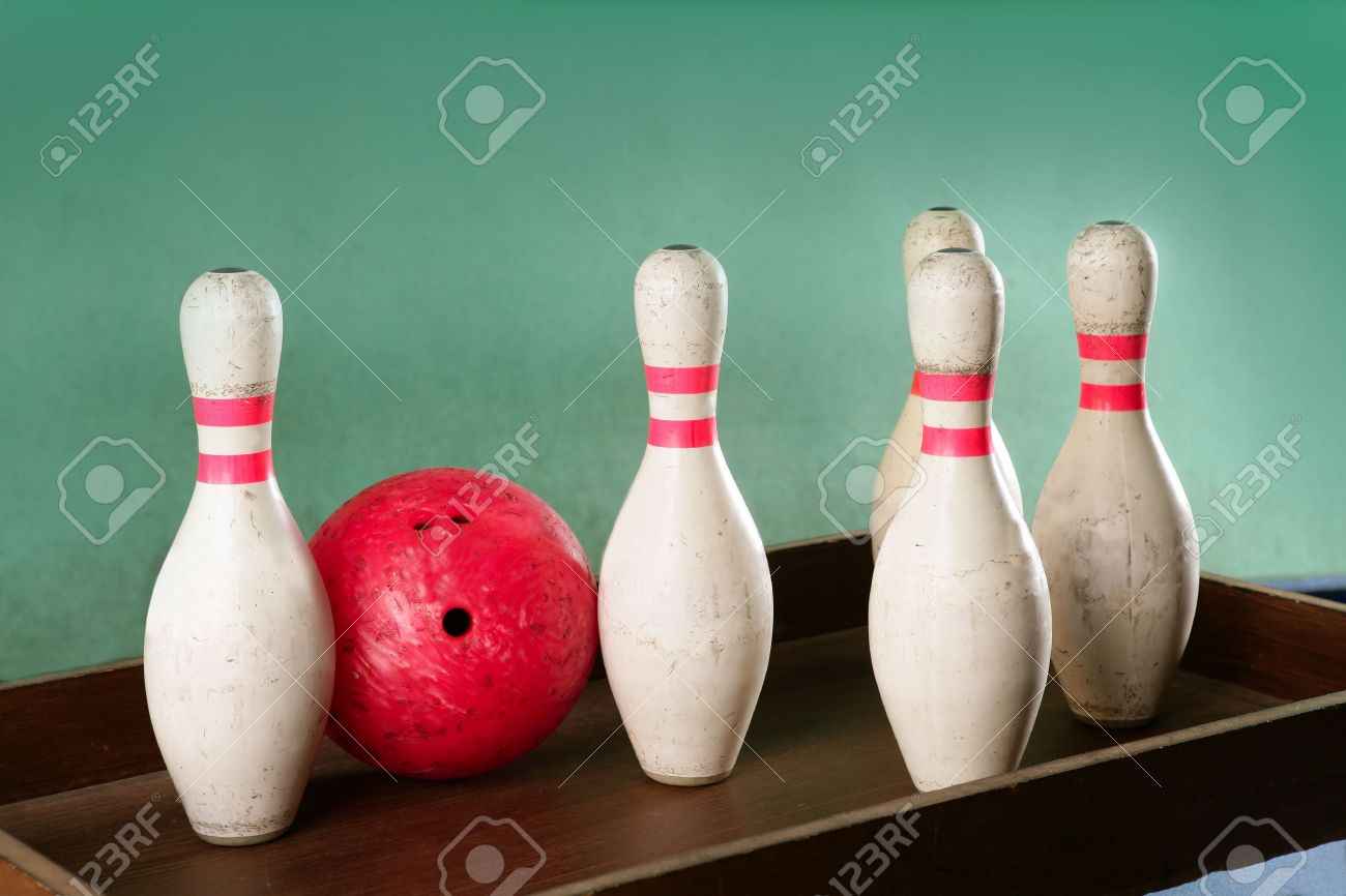 Bowling still life red ball games over green background Stock Photo -  6128721
