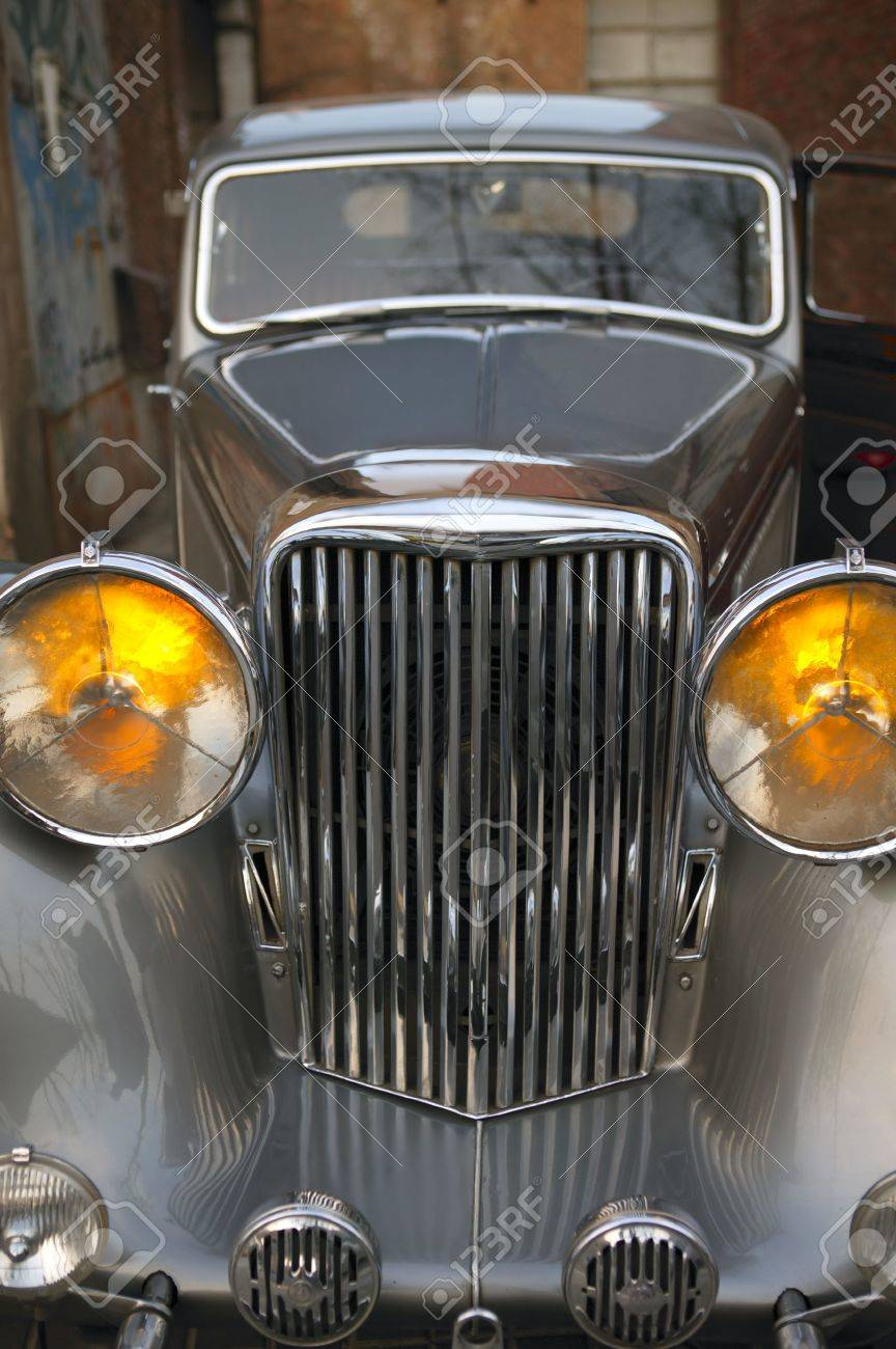 Car vintage,  in silver color, yellow headlights Stock Photo - 6385946