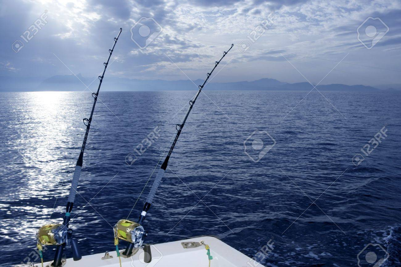Fishing boat trolling with two rods and reels on blue ocean Stock Photo - 6604746
