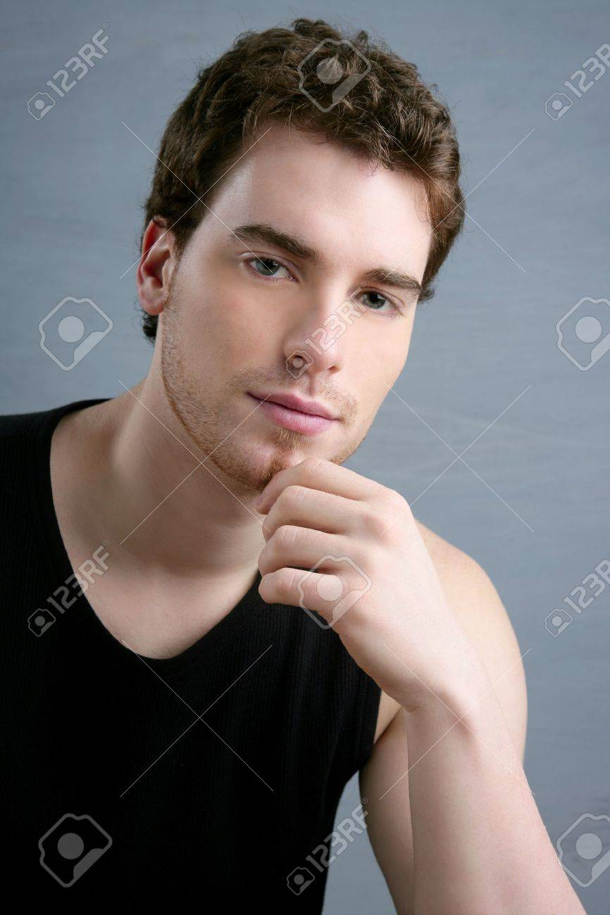 young man portrait posing looking camera over gray background Stock Photo - 6985507