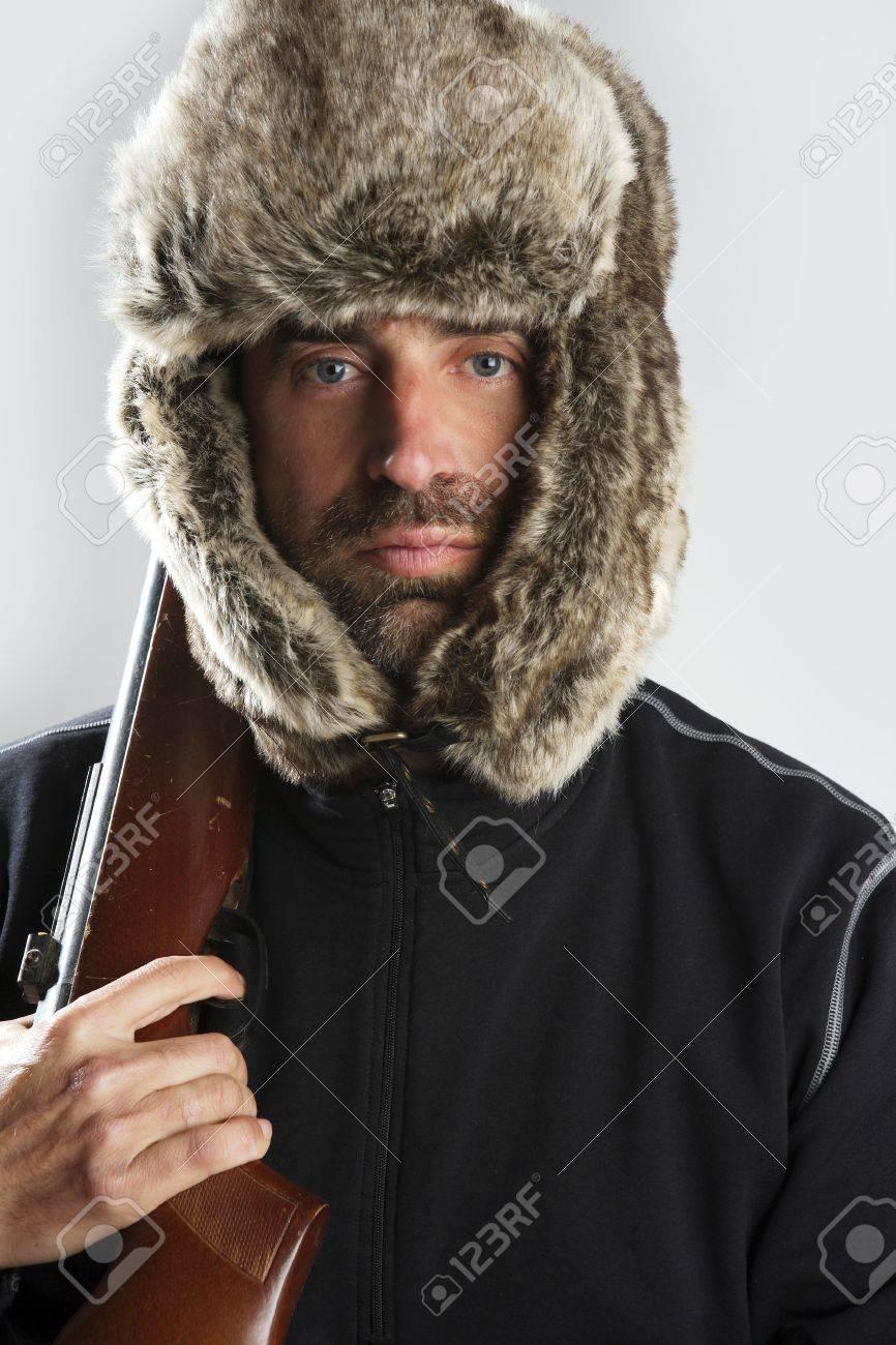 e7170b28972 hunter winter fur hat man portrait holding gun Stock Photo - 6985545