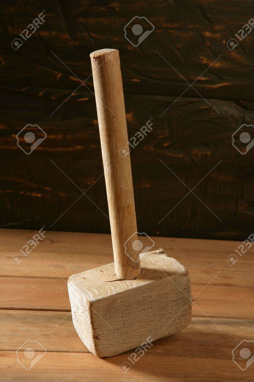 hammer old vintage wooden made over wood background Stock Photo - 7057803
