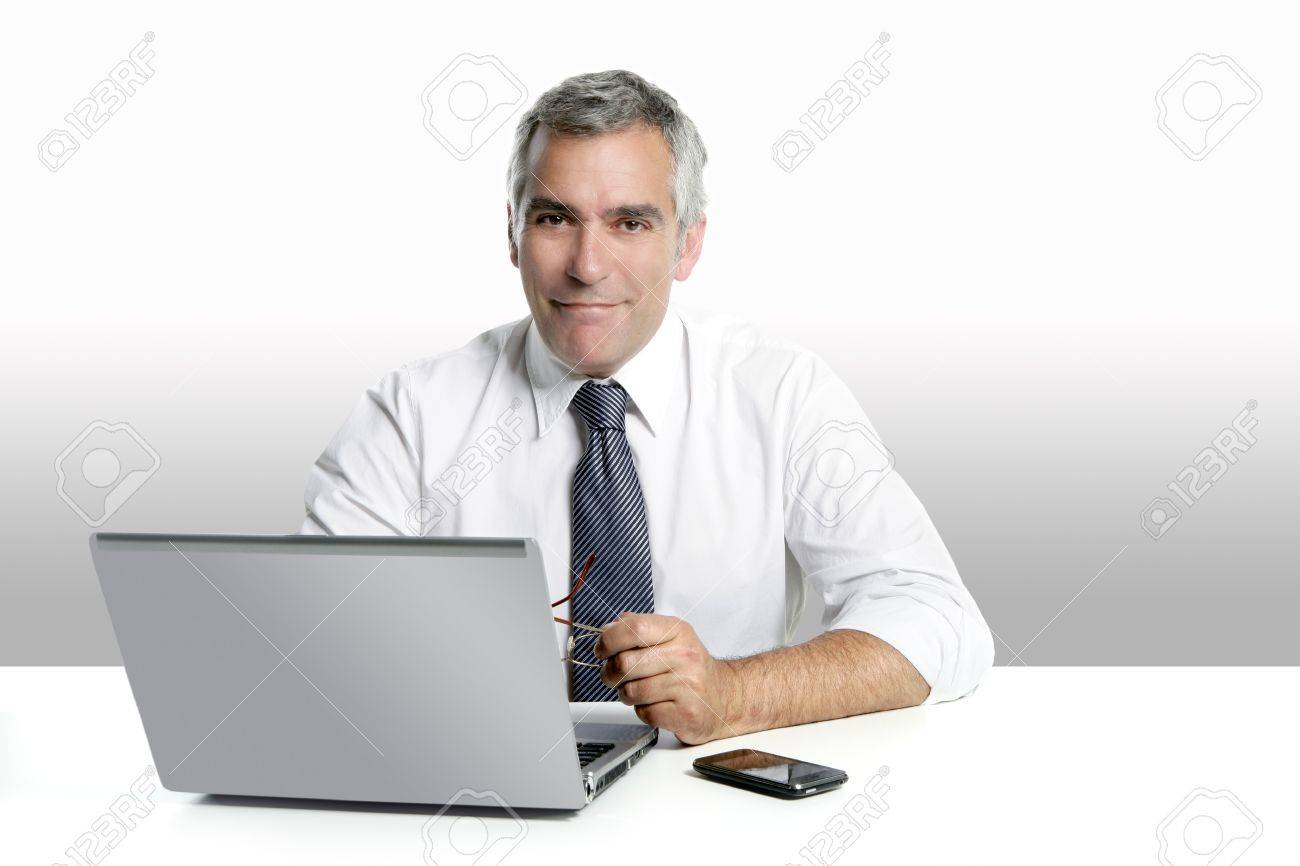 businessman senior gray hair working laptop computer white desk background Stock Photo - 7239843