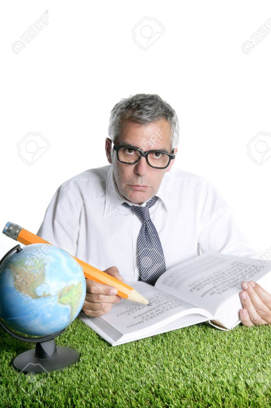 Senior student teacher humor glasses world map book big pencil senior student teacher humor glasses world map book big pencil green grass desk stock photo gumiabroncs Gallery