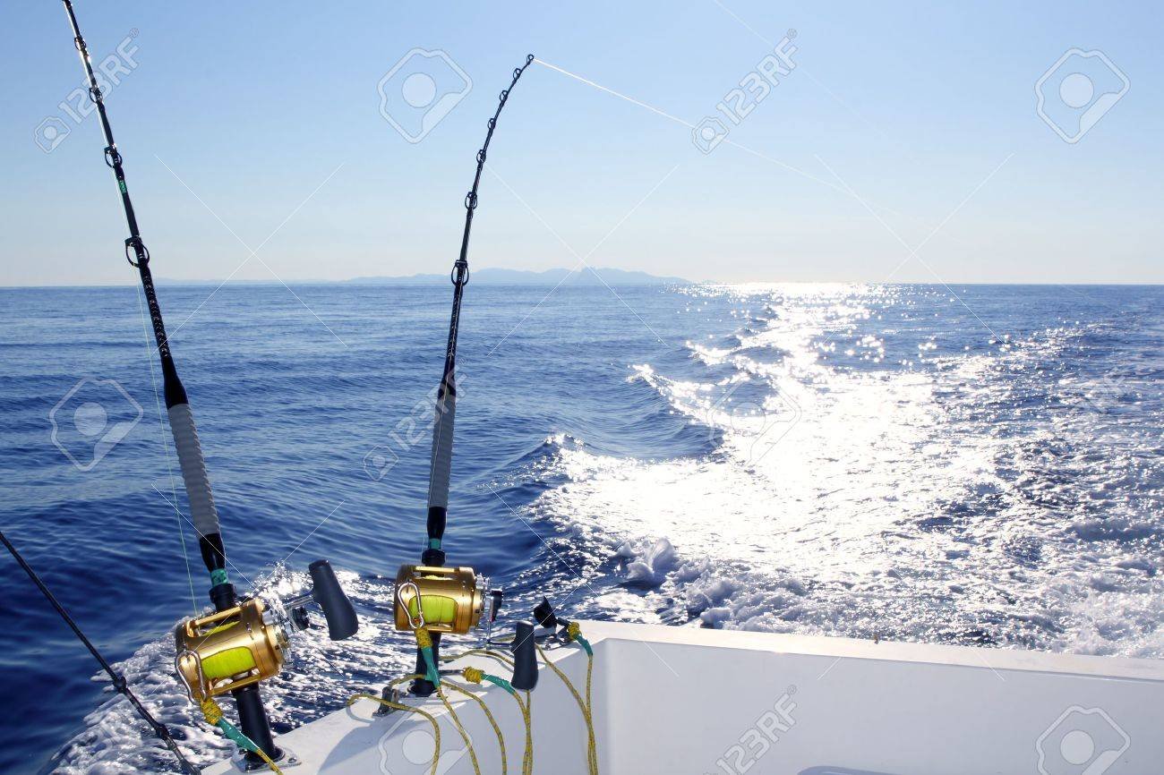 Trolling offshore fisherboat rod reels wake sea reflection horizon Stock Photo - 7433830