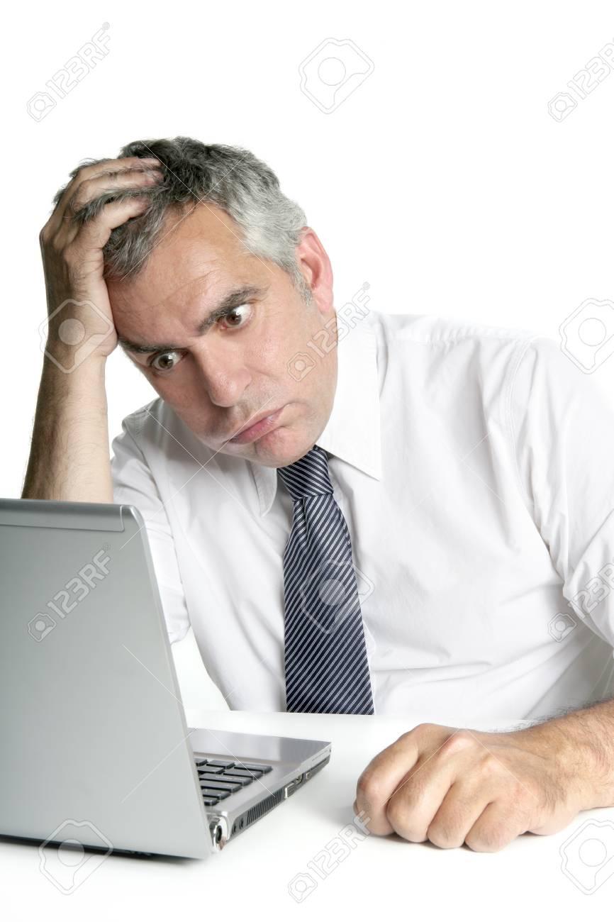 stressed senior businessman gesture working laptop computer white desk Stock Photo - 7473280