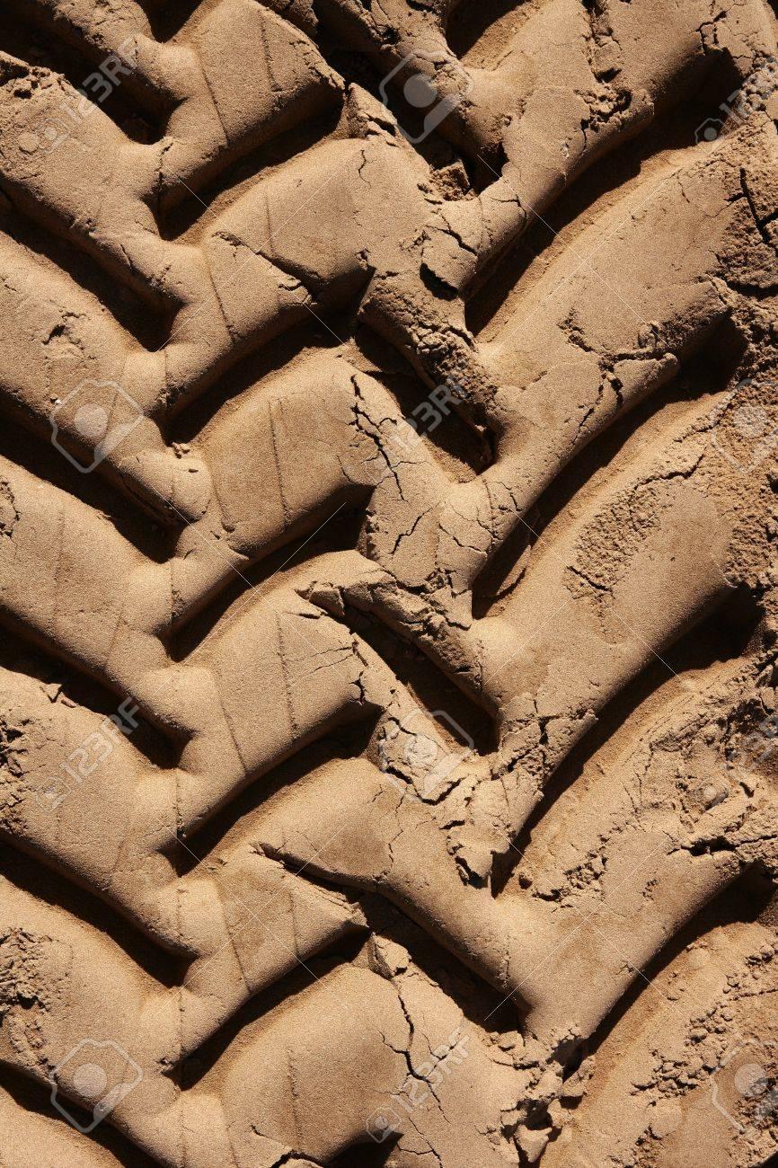 industrial tractor footprint on beach golden sand Stock Photo - 7516170