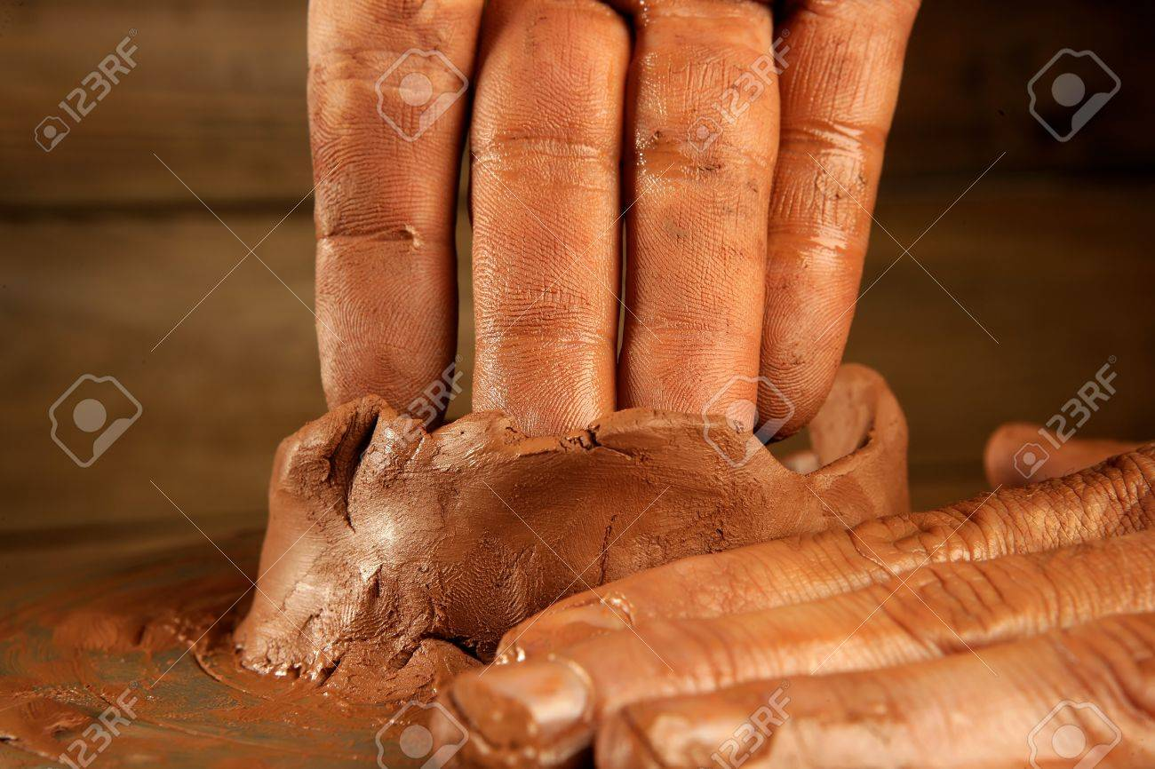 pottery craftmanship red clay potter hands work finger closeup Stock Photo - 7780229