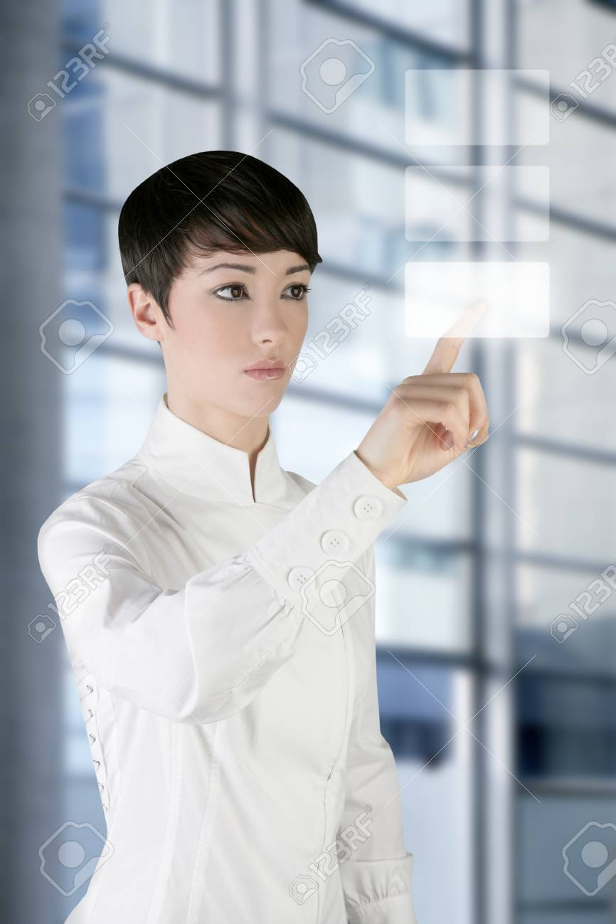 futuristic businesswoman finger touch pad on modern office Stock Photo - 7780621