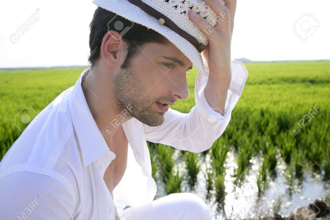 Mediterranean man portrait white hat in green meadow rice field Stock Photo - 7907598