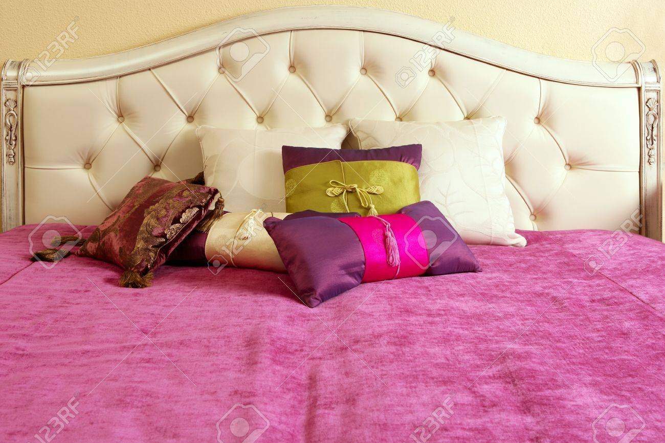 diamond upholstery buttons bed head pink blanket colorful pillows Stock Photo - 8385067