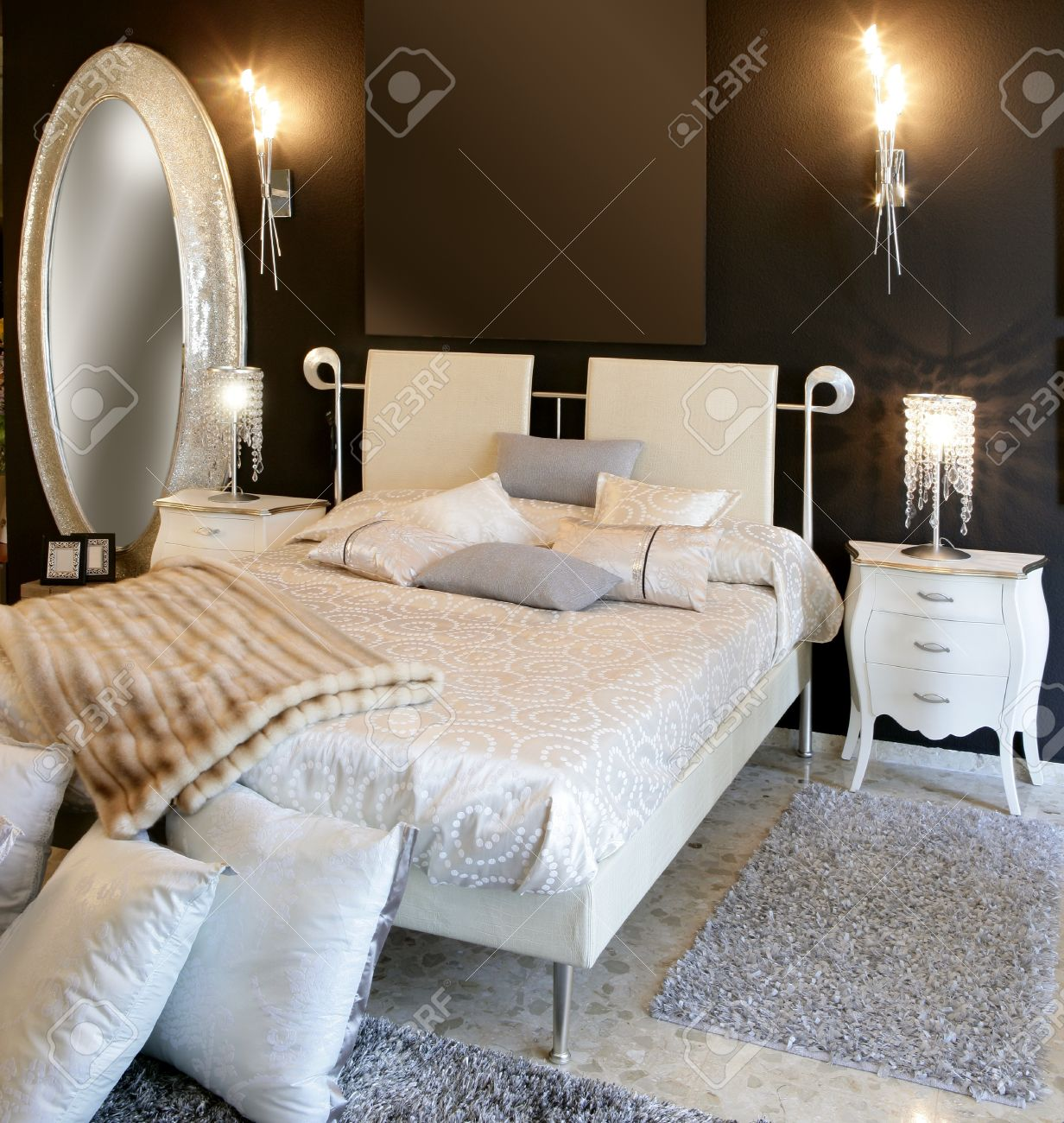 stock photo bedroom modern silver oval mirror white bed black wall black white style modern bedroom silver