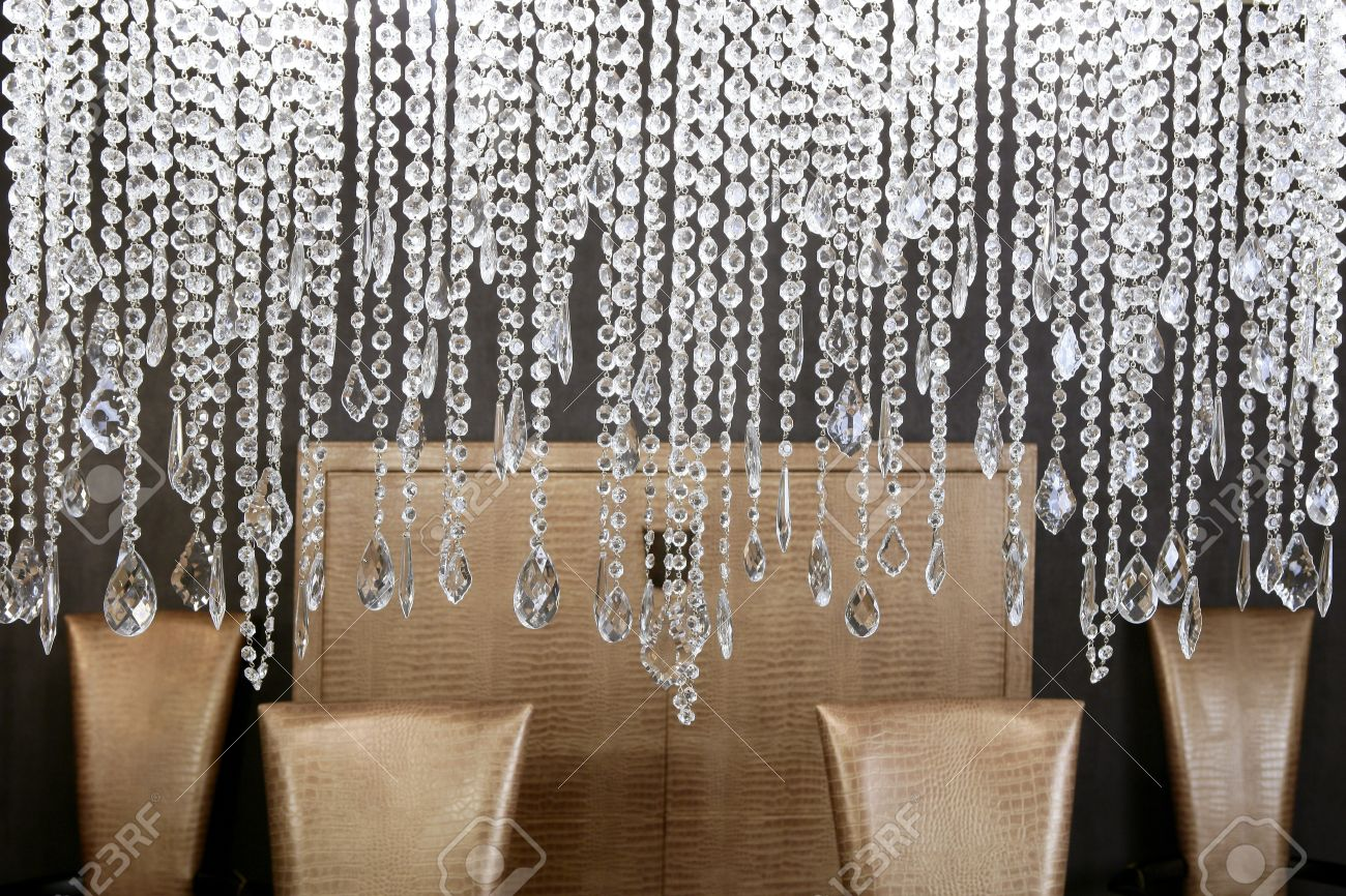 dining room modern crystal strass lamp and crocodile golden chairs Standard-Bild - 8426620