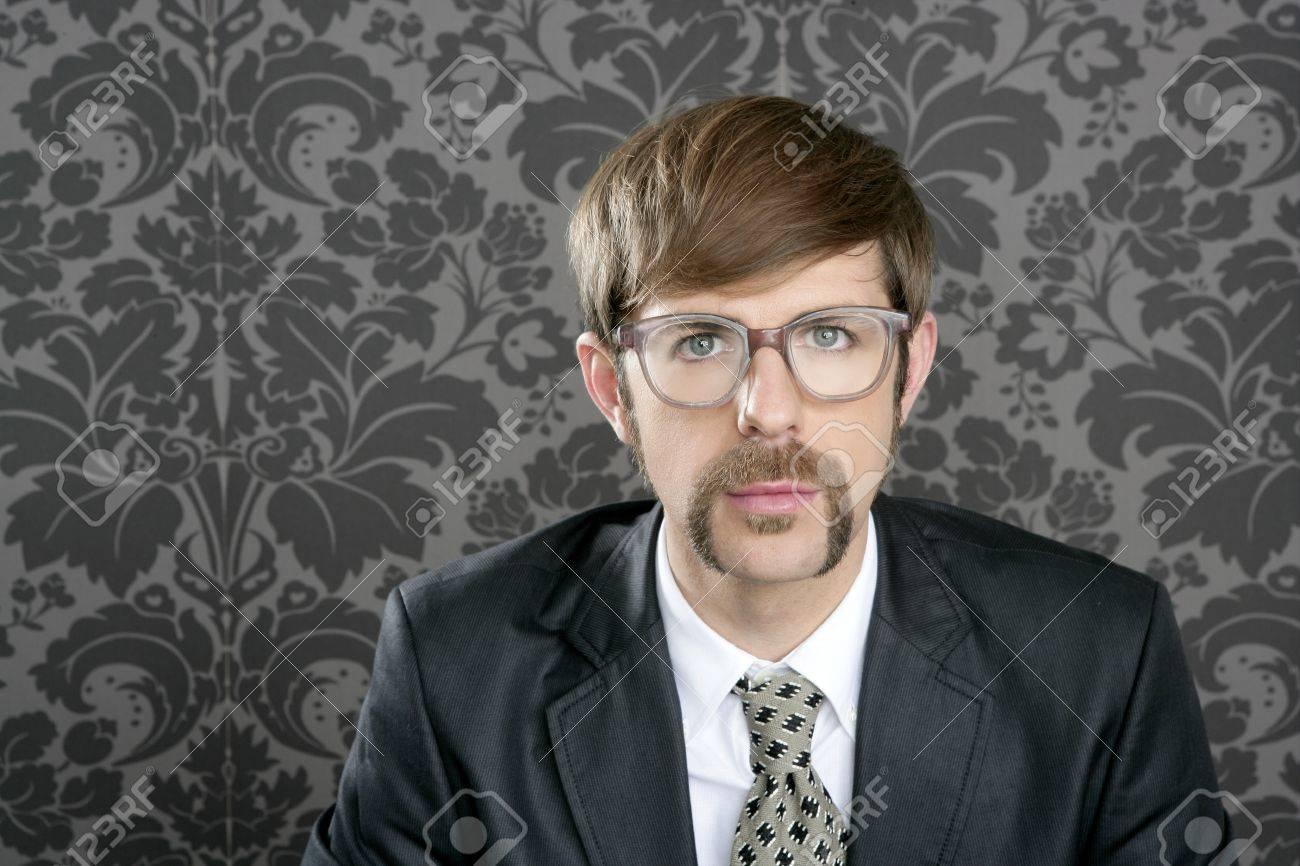 businessman nerd retro glasses geek portrait on vintage wallpaper