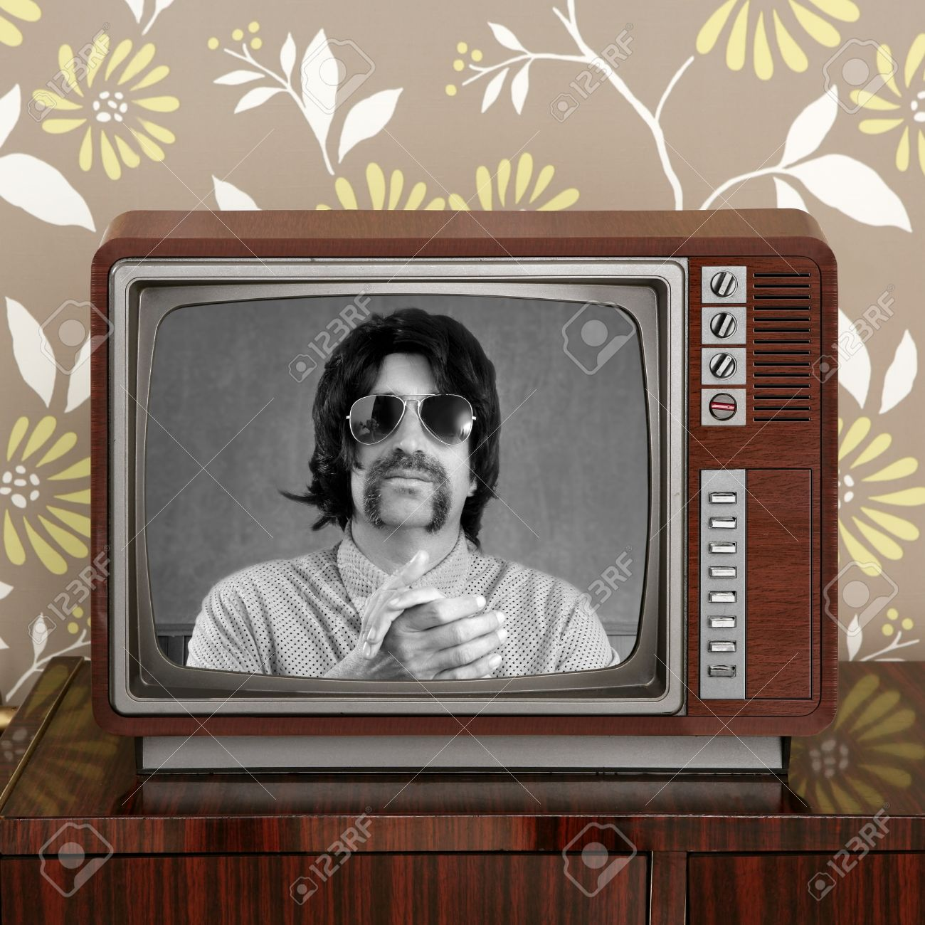 geek mustache tv presenter in retro wood television vintage wallpaper Stock Photo - 8926054