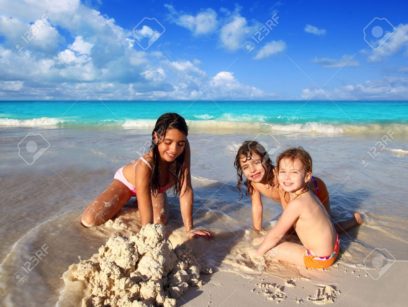 three little girls mixed ethnicity playing tropical beach Caribbean sea Stock Photo - 9030907