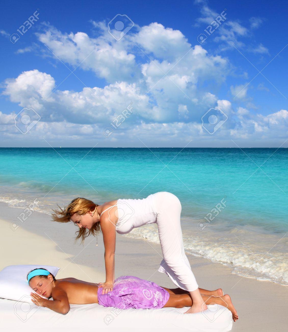 Caribbean beach massage shiatsu waist pressure woman outdoor paradise Stock Photo - 9142402
