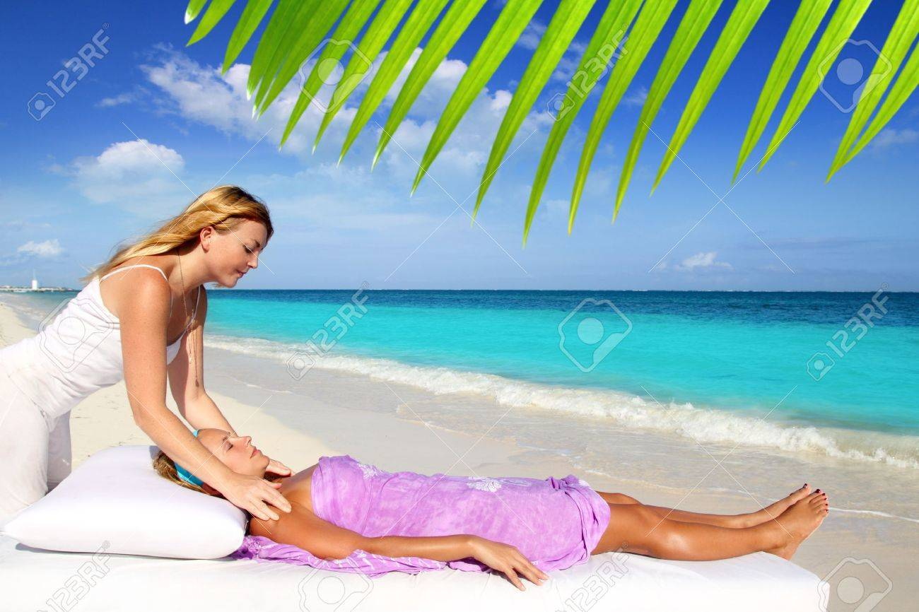 Mayan reiki massage in Caribbean beach woman vacation therapy Stock Photo - 9307547