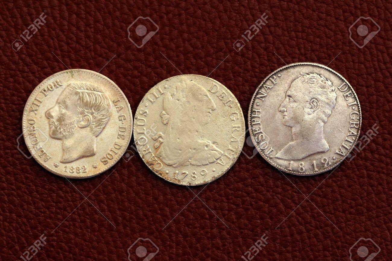 five pesetas spain old coins Alfonso XII Carlos III Ioseph Napoleon Stock Photo - 9494640