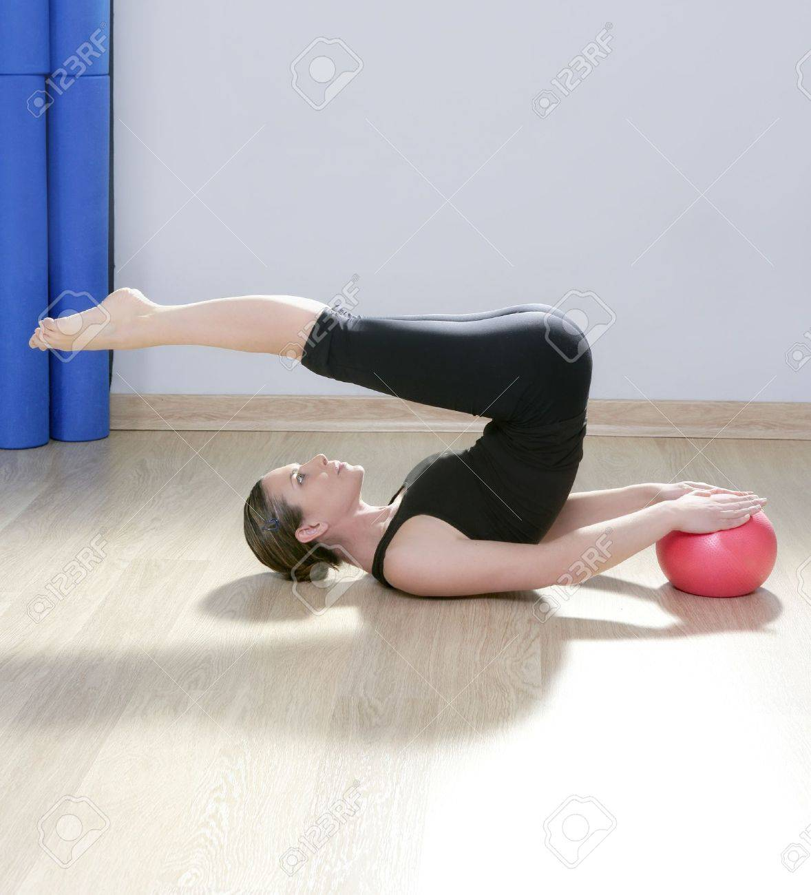 pilates instructor woman with stability ball doing gym fitness yoga exercises Stock Photo - 9942585