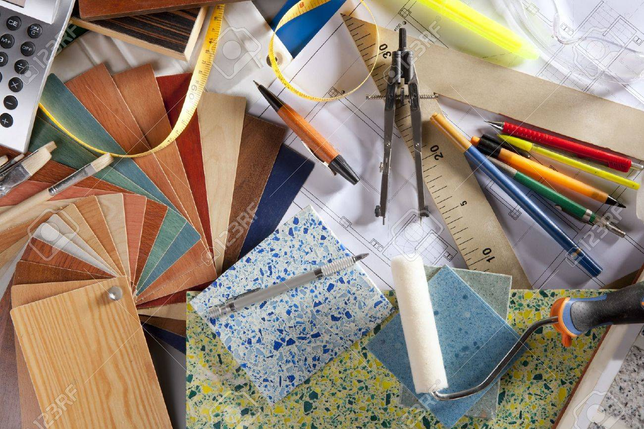 Architect Or Interior Designer Workplace Desk And Design Tools With Lots Of  Construction Material Samples Stock