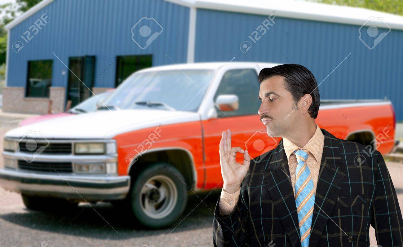 car used salesperson selling old car as brand new  typical topic salesman with hand ok gesture Stock Photo - 10048815
