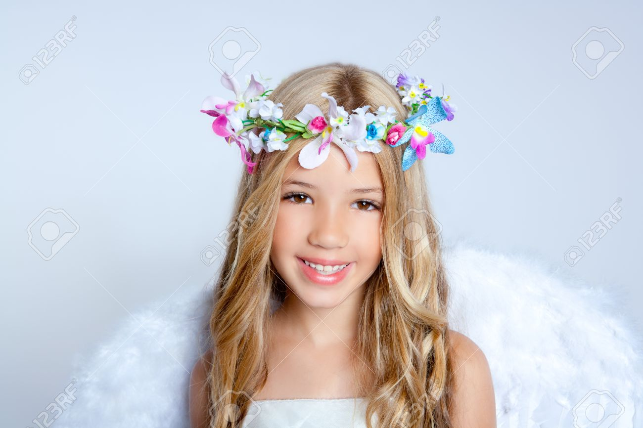 angel children with white wings and flowers crown stock photo