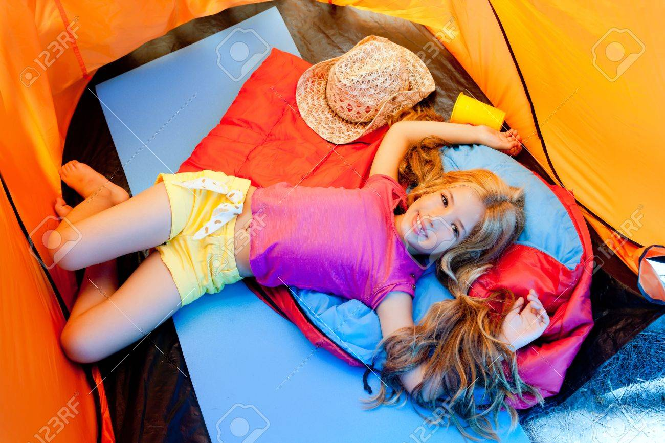 Children girl lying on c&ing tent floor in vacation Stock Photo - 10214513 & Children Girl Lying On Camping Tent Floor In Vacation Stock Photo ...