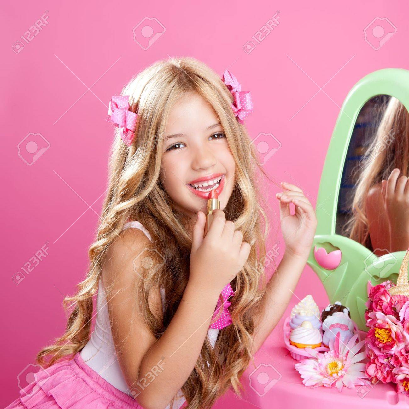 Fashion Little Doll Girl In Pink Vanity Mirror With Lipstick Stock