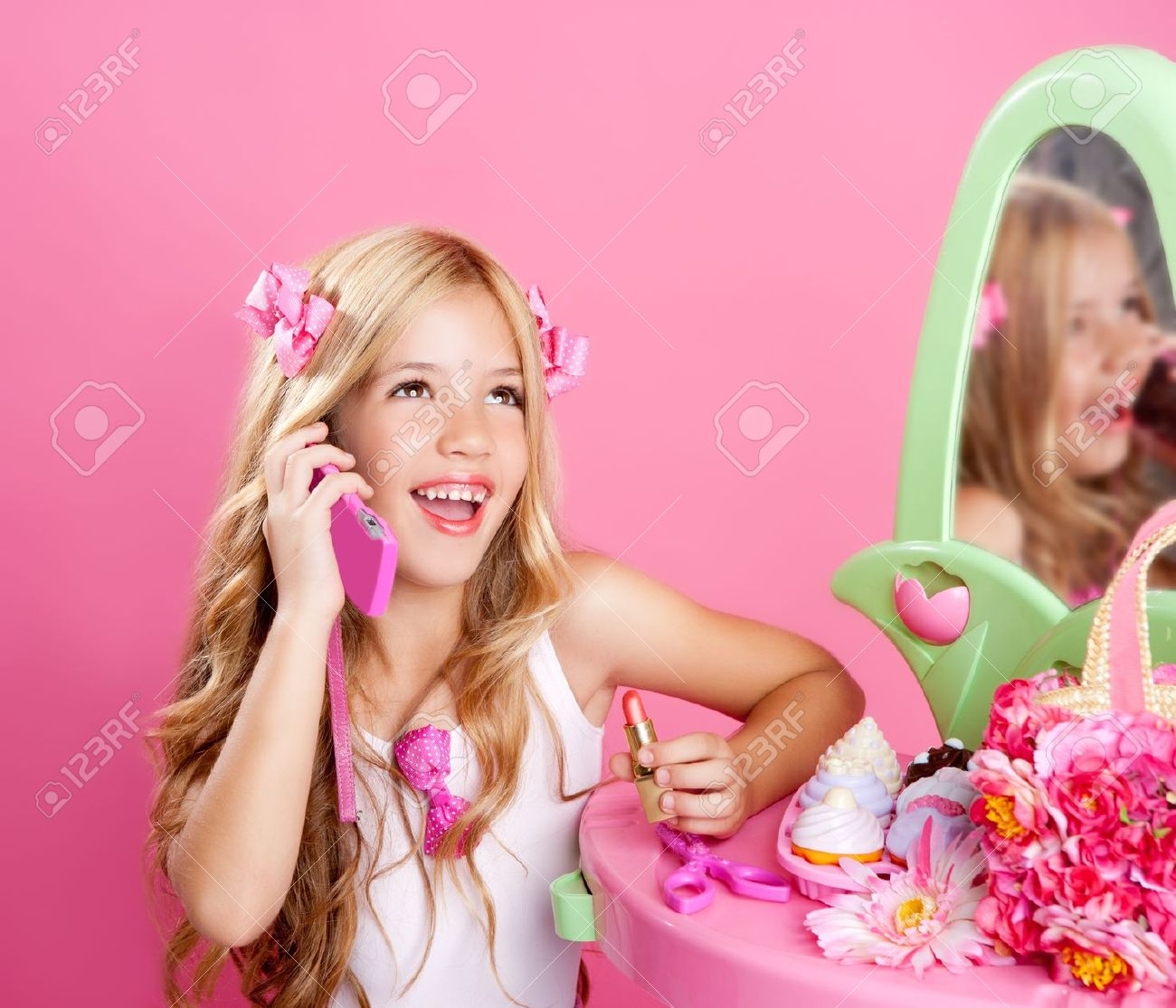 blond fashion doll girl talking with mobile phone in pink vanity Stock Photo - 10215281