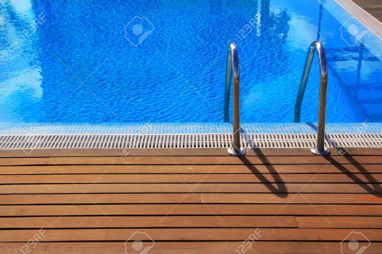 Blue Swimming Pool With Teak Wood Flooring Deck Summer Vacation Stock Photo Picture And Royalty Free Image Image 10438087