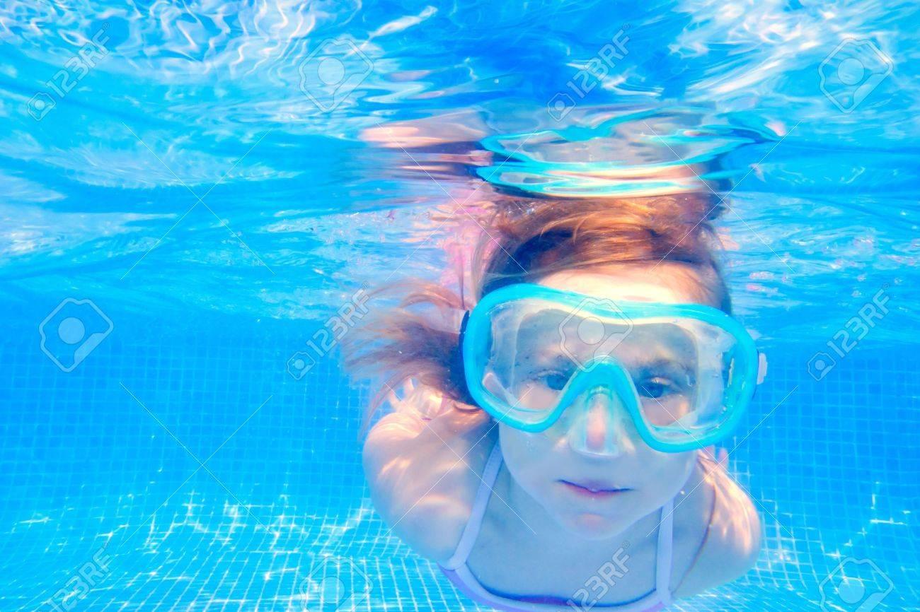 blond child girl underwater swimming in blue tiles pool Stock Photo - 10743472